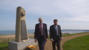 Scannal Whiddy Island Paídraig O'Driscoll and Michael Kingston beside the monument in Pl+®rin